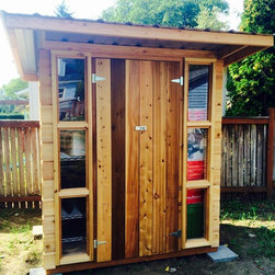 Garden Sheds - This is a smaller 4' deep by 6' wide shed and has vertical windows on both sides of the wooded doors.