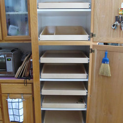 Slide Out Pantry Shelves - Create an organized pantry with custom pull out shelves from ShelfGenie of Portland, designed to fit your existing space.  Increase your ability to see and reach stored in your pantry, ultimately saving you time and money.