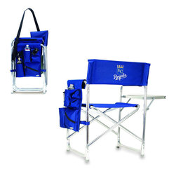 """Picnic Time - Kansas City Royals Sports Chair in Navy - The Sports Chair by Picnic Time is the ultimate spectator chair! It's a lightweight, portable folding chair with a sturdy aluminum frame that has an adjustable shoulder strap for easy carrying. If you prefer not to use the shoulder strap, the chair also has two sturdy webbing handles that come into view when the chair is folded. The extra-wide seat (19.5"""") is made of durable 600D polyester with padding for extra comfort. The armrests are also padded for optimal comfort. On the side of the chair is a 600D polyester accessories panel that includes a variety of pockets to hold such items as your cell phone, sunglasses, magazines, or a scorekeeper's pad. It also includes an insulated bottled beverage pouch and a zippered security pocket to keep valuables out of plain view. A convenient side table folds out to hold food or drinks (up to 10 lbs.). Maximum weight capacity for the chair is 300 lbs. The Sports Chair makes a perfect gift for those who enjoy spectator sports, RVing, and camping.; Decoration: Digital Print"""