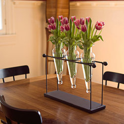 Danya B - Recycled Glass Triple Flower Vase Rustic Metal Stand - Three recycled amphora glass vases on a rustic metal stand with finials will create a dramatic focal point on your indoor or outdoor decor. The glass vases hold single buds or a small bouquet of natural or silk flowers.