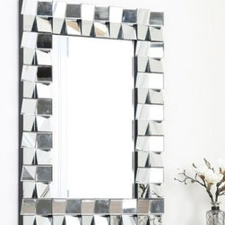 Isabelle Rectangle Wall Mirror - 29W x 41H in. - The Isabelle Rectangle Wall Mirror – 29W x 41H in. features a striking decorative border of slanted square glass tiles, a unique design that catches light—and your attention, too. Durably made from wood and silver-finished glass, this unique, American-designed modern mirror deserves a prominent position on home or office walls.About AbbysonBased in California, Abbyson has been America's leading home lifestyle furnishings brand since 1989. Following a mission that aims to combine style, function, affordability, sustainability and diversity into all their products, Abbyson creates classic and transitional designs that let their customers regain the control in the environments that they call home. With operations in Italy, China, and Germany, Abbyson focuses on using the finest materials, craftsmen, and techniques, from their classic leather furniture sets to organic, hand-knotted Tibetan rugs. Abbyson recently partnered with the Sustainable Furnishings Council as part of their effort to find new ways to bring sustainable practices to home furnishings marketplace. Through their green initiatives and everyday design and construction practices, Abbyson keeps striving to meet their customer's lifestyle needs, and revitalize their day-to-day routines.