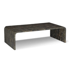Brownstone Hayden Buffalo Coffee Table - Brownstone has carefully crafted a magnificent table collection made with rich, gray brown horn from the water buffalo. Each table has been meticulously prepared by several courses of buffing, sanding and polishing to maximize the spectacular color and grain of the horn. No two tables are exactly a like due to the natural variations of the horn, further adding to the collection's uniqueness and beauty.