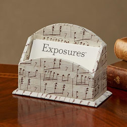 "Exposures - Music Motif Business Card Holder - Overview Made una alla volta (one at a time) from handcrafted paper in a small Florence studio, this music-themed business card holder is the perfect gift idea for a music teacher. Pretty to look at and functional, too!  Features Handmade from handcrafted paper Business card holder Made in Italy   Specifications  Measures 4 1/2"" wide x 3 1/4"" high x 2"" deep"