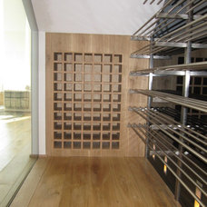 Modern Wine Cellar by CP Construction & Investment