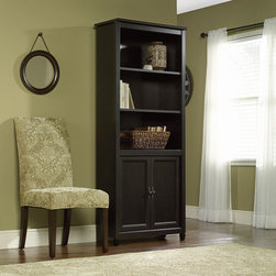 """Sauder - Edge Water Library Bookcase in Estate Black - The clean lines of the Edge Water Collection bring a new spin to cottage style. In keeping with the relaxed sophistication of the collection, each piece is detailed with solid wood sculpted tapered feet, distinctive kick rails, elegant dark Spanish hardware and shapely soft framed doors and drawers. Finished in an elegant Estate Black finish with a warm gold undertone, and designed with a great attention to modern function and storage, Edge Water creates a relaxed oasis that still serves today's mobile technology lifestyle. Features: -Library bookcase. -Edge Water collection. -Estate black finish. -Three adjustable shelves. -Hidden storage behind doors. -Assembly required. -Manufacturer provides 5 year warranty. -Overall Dimensions: 71.88"""" H x 29.25"""" W x 13"""" D."""