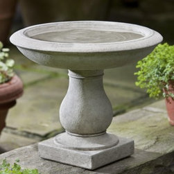 Campania International Beauvoir Cast Stone Bird Bath - About Campania InternationalEstablished in 1984, Campania International's reputation has been built on quality original products and service. Originally selling terra cotta planters, Campania soon began to research and develop the design and manufacture of cast stone garden planters and ornaments. Campania is also an importer and wholesaler of garden products, including polyethylene, terra cotta, glazed pottery, cast iron, and fiberglass planters as well as classic garden structures, fountains, and cast resin statuary.Campania Cast Stone: The ProcessThe creation of Campania's cast stone pieces begins and ends by hand. From the creation of an original design, making of a mold, pouring the cast stone, application of the patina to the final packing of an order, the process is both technical and artistic. As many as 30 pairs of hands are involved in the creation of each Campania piece in a labor intensive 15 step process.The process begins either with the creation of an original copyrighted design by Campania's artisans or an antique original. Antique originals will often require some restoration work, which is also done in-house by expert craftsmen. Campania's mold making department will then begin a multi-step process to create a production mold which will properly replicate the detail and texture of the original piece. Depending on its size and complexity, a mold can take as long as three months to complete. Campania creates in excess of 700 molds per year.After a mold is completed, it is moved to the production area where a team individually hand pours the liquid cast stone mixture into the mold and employs special techniques to remove air bubbles. Campania carefully monitors the PSI of every piece. PSI (pounds per square inch) measures the strength of every piece to ensure durability. The PSI of Campania pieces is currently engineered at approximately 7500 for optimum strength. Each piece is air-dried and then 