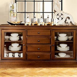 Tucker Buffet, Mahogany stain - Create a wall of cabinetry with the look of a built-in with our Tucker Wall Unit. The generously scaled buffet offers ample space for organizing dining essentials. Add the hutch for a dramatic display. 111.5'' wide x 16.5'' deep x 75'' high Crafted of hardwood and veneers. Hand finished in black, mahogany or rustic pine. Catalog / Internet Only. View our {{link path='pages/popups/fb-dining.html' class='popup' width='480' height='300'}}Furniture Brochure{{/link}}.