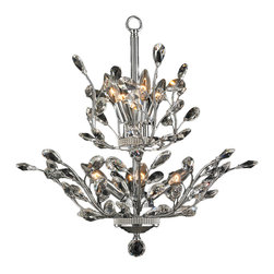"""Worldwide Lighting - Aspen 8-Light Chrome Finish & Clear Crystal Flower Tree Chandelier 21"""" D x 22"""" H - This stunning 8-light chandelier only uses the best quality material and workmanship ensuring a beautiful heirloom quality piece. Featuring a radiant chrome finish and finely cut premium grade crystals with a lead content of 30%, this elegant chandelier will give any room sparkle and glamour. Worldwide Lighting Corporation is a privately owned manufacturer of high quality crystal chandeliers, pendants, surface mounts, sconces and custom decorative lighting products for the residential, hospitality and commercial building markets. Our high quality crystals meet all standards of perfection, possessing lead oxide of 30% that is above industry standards and can be seen in prestigious homes, hotels, restaurants, casinos, and churches across the country. Our mission is to enhance your lighting needs with exceptional quality fixtures at a reasonable price."""