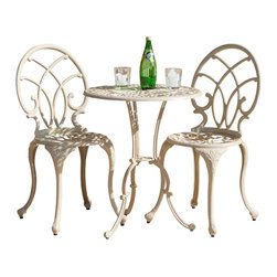 Great Deal Furniture - Andover Sand Aluminum 3pc Bistro Set - The calming off-white sand color naturally provides the perfect accent for the beautifully designed chairs, but also provides the perfect accent for any decorating style. This gorgeous shade helps to brighten up any patio or deck. The seemingly endless curves provide not only ornate styling, but also seamlessly merge into the structural supports, hiding these usually boring parts of furniture.