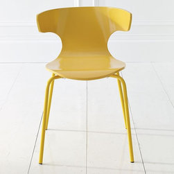"Wrap Dining Chair - This simple chair from West Elm deserves props for its curves. It's a standout as a desk or dressing table chair, and is also smashing in a set around a round kitchen table or rectangular dining table. I'm signing up for the sunny yellow myself.Lacquered birch plywood seat.Low wingback silhouette and waterfall at knee for maximum comfort.Sturdy steel legs.20.5""w x 22""d x 29""h; 18.5""h seat."