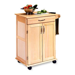 Home Styles - Home Styles Dainty Wood Kitchen Cart - 5040-95 - Shop for Carts from Hayneedle.com! The Home Styles Dainty Wood Kitchen Cart is constructed of a sturdy solid wood in a Natural finish. Its frame is accented with brushed steel hardware. This kitchen cart features a double door storage cabinet with adjustable shelf. This cart also has a towel holder which is placed right within your hand's reach. This cart is equipped with heavy duty locking plastic casters so you can easily move it or lock it into place. About HomestylesHomestyles is a manufacturer and distributor of RTA (ready to assemble) furniture perfectly suited to today's lifestyles. The great difference between Homestyles and many other RTA furniture manufacturers is that all Homestyles pieces are crafted of solid wood an important quality. When shopping for convenient durable items for the home look to Homestyles. You'll appreciate the value.
