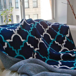 Taj Throw Blanket - Inspired by Moroccan and Indian wrought iron designs, our Taj print is an instant classic. These soft throws are perfect year-round ... whether for cool summer nights or in the winter by the fire! Ideal size for the foot of a bed or on your favorite chair. Throw features contrast knit on reverse side with colors used on front. 80/20 cotton/acrylic blend; machine washable. Made to order by Christen Maxwell in the USA