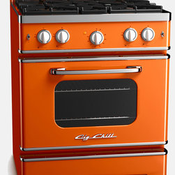 Vintage Inspired Retro Stove, Orange - This vibrant orange oven definitely makes me want to whip up a batch of pumpkin spice muffins! I found this oven at Big Chill, which is probably the neatest kitchen store I have ever come across. You can find the coolest refrigerators, ovens and dishwashers all in a retro, '50s style. If you take a look at Rachel Ray's kitchen on her show, you can tell even she uses a Big Chill refrigerator.