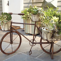 Bicycle Planter - This planter features wrought iron with looped wire baskets to showcase your spring flowers, and the old-fashioned kickstand holds the bicycle in place. This makes a fun and unique addition to any yard.