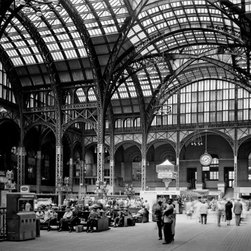 Pennsylvania Station, 370 Seventh Avenue, Concourse from South East Print - Pennsylvania Station, 370 Seventh Avenue, West Thirty-first, Thirty-first-Thirty-third Streets, New York, New York, NY. Cervin Robinson, Photographer April 24, 1962. Other Title: Penn Station Related Names: Charles Follen McKim, William Rutherford Mead, Stanford White. Photo 5 x 7 in. Building/structure dates: 1903 initial construction Building/structure dates: 1963 demolished Significance: The construction of Pennsylvania Station was one part of a large building program undertaken in 1903 by the Pennsylvania Railroad Company. Included in this program was the construction of tunnels under the North River, which enabled Pennsylvania Railroad trains to enter Manhattan directly from New Jersey for the first time. Because the trains entered on tracks below ground level, the architects did not follow any of the more common architectural forms for a railway station and designed instead a rather low, colonnade facade...The rich sequences of spaces in the terminal culminated in the great concourse with its glass and steel roof. The design of the main waiting room was reputedly based on the Roman Baths of Caraculla. From a planning standpoint, the station was important for its separation of various forms of transportation on different levels and for the convenience of its many entrances and exits to the city. Pennsylvania Station was built during the Golden Age of railroading, when its owners intended the terminal not only to serve the specific needs of the railroad by also to embellish the city as a monumental gateway.