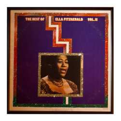 "Glittered Ella Fitzgerald Best of Vol II Album - Glittered record album. Album is framed in a black 12x12"" square frame with front and back cover and clips holding the record in place on the back. Album covers are original vintage covers."