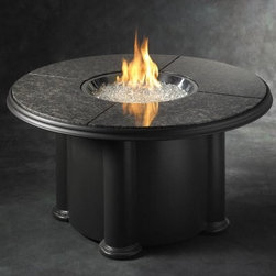 Outdoor GreatRoom Grand Colonial Granite Fire Pit Table - Whether you're hosting a full-blown neighborhood barbeque or romantic night in, the Outdoor GreatRoom Grand Colonial Granite Fire Pit Table sets that perfect scene in your outdoor living area. UL-listed for outdoor use, this fire pit table features a granite top and outdoor-grade fiberglass base that stores a 20-pound liquid propane tank. The hassle-free electronic piezo lets you control the flame height, and the table comes complete with Diamond Glass gems to place in the stainless steel fire pit burner.About Outdoor GreatRoom CompanyWith over 50 patents to its name, the Outdoor GreatRoom Company is one of the most innovative names in gas fireplaces and outdoor design, period. Since 1975, Dan, Ron, Steve, and Ger have produced a yard of amazing products, like the Heat-N-Glo, that have changed the industry. In fact, they want to change the way you think about your backyard or patio. It's about bringing the luxury and comfort of the living room outside to make an Outdoor Room. They want you to, literally, think outside the box. To make that beautiful concept a reality, Outdoor GreatRoom designs, manufactures, and sells pergolas, outdoor kitchens, grills, outdoor furniture, fireplaces, fire pits, lighting, and heating products. There's no better name in outdoor leisure than this fine Minnesotan company.