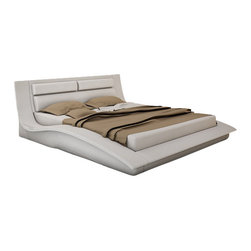J&M Furniture - J&M Wave White Leather & Lacquer Queen Size Platform Bed - The Wave platform bed is a beautiful piece of today's modern furniture that works well with any decor. This bed comes upholstered in a stunning white leather on the headboard. The headboard has a stylish multi-pillow look perfect for comfortable head support. The frame comes in a white lacquer finish. The price shown here includes a queen size bed only. A mattress does NOT come included with the bed.