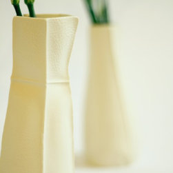 Souda - Kawa Vases - Kawa Vases by Souda are a series of porcelain vases which have been slip-cast in leather molds. The resulting pieces are batch-produced, one of a kind vases which closes resemble the leather molds in which they were cast.