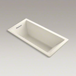 """KOHLER - KOHLER Underscore(R) 66"""" x 32"""" drop-in bath - Featuring a simple, crisp design, this Underscore bath exudes understated style with contemporary flair. The sloped backrest offers extra comfort and support during your soak."""