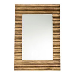 Nicola Small Mirror - Hand-routed concave ribs in the Nicola Small Mirror's frame make its outlines feel intriguingly continuous, superimposing the reflection of the room on a look that's reminiscent of rustic staples of decor like cabin wood and farmhouse siding.  A glowing richness updates this timeless quality, however, as the wood is hand-dressed in sheets of antique brass.