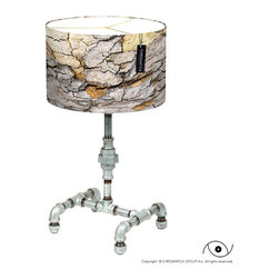"""ARTURITO TABLE LAMP - We named this lamp """"Arturito"""". made of galvanized steel pipes with the """"SJU001"""" lamp shade. The bricks is a detail of a cobblestone pavement, located on the streets of Old San Juan, Puerto Rico. The cobblestones were originally removed from iron smelters in XV c. Spain. The Spanish conquistadors used them as counterweight on their tall ships in order to replace them for gold taken from the Americas. In San Juan were used to pave sandy roads. Now this is a PR symbol."""