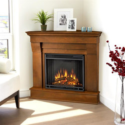 Real Flame - Chateau Corner Electric Fireplace in Espresso - 1400 Watt heater, rated over 4700 BTUs per hour. Programmable thermostat with display in Fahrenheit or Celsius. Ultra Bright LED technology with 5 brightness settings. Digital readout display with up to 9 hours timed shut off. Dynamic ember effect. Fireplace includes wooden mantel, firebox, screen, and remote control.. Solid wood and veneered MDF construction. 40.9 in. W x 25.3 in. D x 37.6 in. H (77 lbs.)The Chateau Corner Fireplace features the clean lines and classic styling familiar to stone mantels, realized in wood. In three great finishes, this design is sure to compliment a variety of decor, from the classic to contemporary. The Vivid Flame Electric Firebox plugs into any standard outlet for convenient set up. Thermostat, timer function, brightness settings and ultra bright Vivid Flame LED technology.