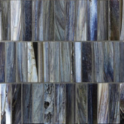 "Glass Tile Oasis - Sapphire Shimmer 1"" x 4"" Blue Pool Frosted Glass - Sheet size:  1.05 Sq. Ft.   Tile Size:  1"" x 4""   Tiles per sheet:  36    Tile thickness:  1/4""   Grout Joints:  1/8""   Sheet Mount:  Paper Face    MADE TO ORDER-LEAD TIME 2 WEEKS     Sold by the sheet    - Brilliant transparent glass combed through with coordinating opaque colors  and featuring a contemporary smooth-edge. Each piece is hand-poured and unique  designed with a certain amount of variation and variegation of color  tone  texture and shade for a distinctive appearance. Our handmade process incorporates creases  wrinkles  waves  bubbles and other surface effects indicative of handmade glass  all designed to capture light and enhance the final beauty of the project."