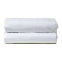 "Parachute - Parachute Percale Sheet Set In White - Most easily compared to the perfect white shirt, Parachute's percale sheet set is cool and crisp to the touch, with a lovely matte finish. It's everything you need to achieve that perfectly lived-in bedroom style. Each fitted sheet features a continuous elastic hem and 16"" deep corner pockets. The signature Parachute pillowcases are designed with a center-back envelope closure that's meant to hug a pillow tight and create a clean look."