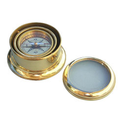 """Round Gimbaled Brass Desk Compass - The Round Gimbaled Brass Desk Compass is a beautiful reproduction of an antique brass compass in a heavy round case.  The 2 3/4-inch (7 cm) diameter compass is marked """"Stanley London 1941"""" and the compass is fully gimbaled with a solid brass gimbal set.  The case measures 4 5/8 inches (11.7 cm) in diameter and 2 3/8 inches (6 cm) tall, and weighs almost 2 pounds (900 grams).  The bottom of the compass is covered with dark felt.  The top glass is beveled and can be unscrewed to expose the compass, which is protected by a second glass cover.  This elegant compass makes a beautiful addition to a nautical collection or executive's desk."""