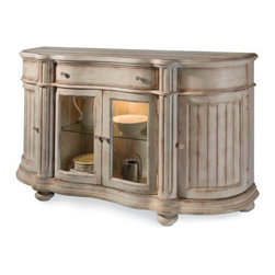 A.R.T. - A.R.T. Belmar II Sliding Door Sideboard in White - Belmar conjures an atmosphere reminiscent of generations of summer afternoons spent at a family coastal cottage. A warm, casual environment is conveyed by heirloom like pieces, passed down from family to family through the ages. A beautifully unique, weathered hand painted finish is enhanced with nicks, rasping, worm holes and a sand-thru appearance. Several pieces are scaled down in size for a cosy fit in a summer cottage or condo, and the adapts wonderfully to a variety of lifestyles! This uniquely curved piece features a distinctive serpentine shaped top with turret shaped pilasters. The ends feature a cleverly placed touch latch door concealing an area to store one table leaf. The display area behind the two center glass doors is illuminated by a touch light and has a glass shelf and planked back. A fixed shelf is located behind each of the curved side doors. Thick step molding, dentil molding, and wide fluting are all key elements of this piece, in which the lovingly aged finish is particularly apparent, with the natural wood showing through at the corners and all other hand rubbed edges.