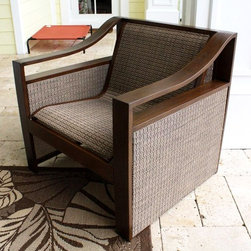 Hospitality Rattan - Venetian Sling Patio Lounge Chair in Dark Bro - Made of Extruded Aluminum Frame will not rust w Twitchel fiber. Finished in a powder coated Dark Bronze finish. Weather and UV resistant. Frame will not rust. Does not require cushions very comfortable. Fully assembled. Overall: 30 in. L x 33 in. W x 32 in. H (25 lbs.)This contemporary sling deep seating known as Venetian incorporates a tubular extruded aluminum frame that will not rust. Made with an exclusive Twitchel brand Sling fiber is used in place of cushions on the seating pieces. The best feature of this set is that it does not require cushions, and is very comfortable. The tempered glass on the coffee table and end table can actually be removed and stored, as the tables have sling and aluminum beneath the glass. This collection matches the Chub Cay dining group and chaise lounge collection.