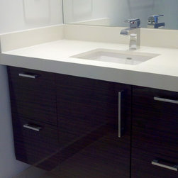 modern bathrooms - Floating vanity design,  custom made cabinets thermofoild doors, zebrawood color and plywood cabinet box.