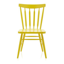 Willa Yellow Side Chair - These Willa chairs from Crate & Barrel are so fun. Pick a bold color for your kitchen table or mix and match — they come in a variety of fun colors.