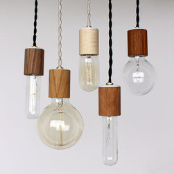 Wood Veneered Pendant Light with Bulb by Onefortythree - I love these simple and great-looking lights. They would be cute clustered above a reading chair or in the kitchen.