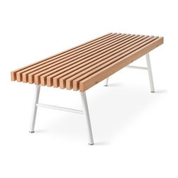 Gus Modern - Transit Bench | Gus Modern - Inspired by simple forms and honest materials, Canadian furniture design and manufacturer company Gus* Modern creates furniture and accessories suited for compact urban dwellings. The Transit Bench has a clean, simple, slatted wood design, a perfect fit for tight spots like entryways and bedrooms. Whether used as seating or as a unique coffee table, the Transit Bench has a pleasing, minimalist design that complements your modern interior. Its powder-coated, tubular steel legs are splayed  for stability. Constructed from 100% FSC®-Certified wood, the bench top is claimed from environmentally responsible forests. The Transit Bench design is perfectly suited for the scale and functionality needs of today. Offered in your choice of wood finish and leg color options. Product Features:  FSC®-Certified Ash top Powder-coated, tubular steel legs Leg bumpers protect hardwood floors