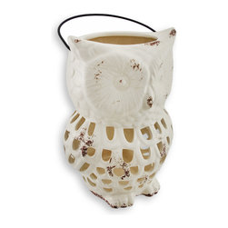 Ceramic Owl Lantern Open Work Design White - Be entertained with a unique light show that will shine from this lantern! Light flows through the cutouts and dances on whatever surface it sits on. It is hand fired and painted with a glossy enamel, and has a touch of `oxidation` to give it that weathered appeal. It measures 10.5 inches tall, 7 inches across and 6 inches deep, has a 4 inch metal handle fits up to a 4 inch thick candle. Use a piller style for full effect, or a tea light for just a hint of lighting. A fun piece for your patio or to light the way into your backyard garden oasis.