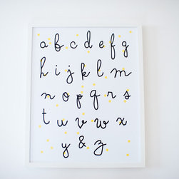 ABC Poster - Adding wall art is one of my favorite ways to make a nursery interesting. Alphabet prints are a dime a dozen, but this one by Hugo Loves Tiki has the most fabulous font and subtle yellow polka dots in the background.