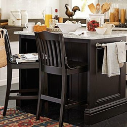 """Conrad Rectangular Wood Kitchen Island, Berry Black finish - Seamlessly expand kitchen workspace with this beautifully crafted island. Designed to capture the look of built-in cabinetry, it has a Carrara marble top and an open space in back to accommodate two bar stools (sold separately). 48.25"""" wide x 29"""" deep x 36"""" high Crafted of kiln-dried hardwood and white Carrara marble. Features two fixed and two adjustable shelves, a towel rack, and hooks on sides to keep essentials within reach. Two drawers provide extra storage. Finished by hand in Berry Black."""
