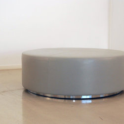 """Benches & Ottomans - This large ottoman is 48"""" in diameter and fabricated in a smooth Holly Hunt Silver Milano leather, with double top stitching. The base is polished chrome."""