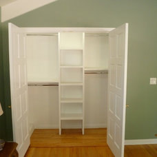 Traditional Closet by YD Construction and Development