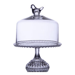 "Home Essentials - Glass Footed 12  Cake Platter with Dome Cover - A lovely stage for the delectable dessert, this footed covered cake platter with the bird finial is a most graceful table centerpiece. The glass dessert dome allows you to reveal and conceal the cake, tortes, or fruit and cheese and the pedestal dessert stand. Simple in shape and yet timeless design on the stand, this cake plate is ideal for weddings, mother's day or any family gathering and special occasion.  * Dimension: 14.5"" tall * Dome 10.13"" Inside Diameter x 10H (including bird decoration on top)"