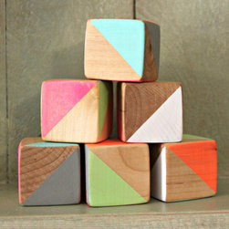 Neon Geometric Triangle Wood Blocks by Arthur N. Craft - These handmade wooden blocks would provide a nice decorative accent to a shelf or windowsill now and then make a classic toy later on. You should be aware that the paint, while nontoxic, is not meant for teething babies, so save these on a higher shelf until baby is a bit older.