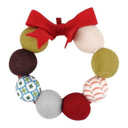 Fabric Wreath Ornament - You could almost make this little wreath yourself to add to door handles for a festive, fun touch anytime of year.