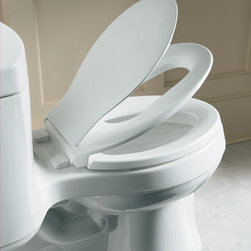 Kohler - Kohler K-4732-0 White Transitions Transitions Elongated Closed-Front - Product Features:Elongated toilet seat with lid - designed to complement a wide variety of elongated toilet designsTransitions seats are designed to meet the needs of both adults and children without requiring separate seatsThe Q3 advantage seats feature technologies that keep the seat from slamming, and simplifies both cleaning and installationMade of solid polypropylene and is resistant to staining, fading, chipping and peelingSeat is ergonomically contoured to provide maximum comfort to the userComplete with color-matched plastic hingesProduct Technologies / Benefits:Transitions: A multi-layered toilet seat gives you the ability to provide and extra secure seat for your young ones while maintaining the classic comforts an adult prefers. Transitions toilet seats are designed to accommodate the needs of both adults and children simultaneously without attaching a separate seat. Grip-Tight Bumpers: These rubber bumpers provide added security as well as less shifting of the seat while in use.Quiet Close: This quiet close lid forces a gentle descent guaranteeing that your seat will never slam as you put it down.Quick Attach: To get you fast on your way to enjoying your new toilet seat, the Quick-Attach Hardware from Kohler makes for fast and secure installation. Simply set the seat with the screws in pre-drilled installation holes, slip a wing-nut underneath and tighten from the top with a screw driver, itÂ's that easy.Quick Release: This simple yet innovative technology from Kohler allows the seat to be unlatched from the toilet for easy removal and convenient cleaning with no tools required. Simply pop open the caps and gently pull the seat forward and you are ready for that detailed cleaning job that has been so difficult in the past.