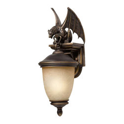 Triarch International - Gargoyle Energy Saving Small Outdoor Wall Mount - This energy saving outdoor lantern will guard your entrance proudly.  Its striking design boasts premium handcrafted tri-stone and handblown cognac antiqued glass.  The oil rubbed bronze finish flaunts hand painted gold highlights, and the confident gargoyle crowns the piece boldly.  Please note that the bulb is included.  The backplate measures 5 3/4W x 4 1/2H, overall backplate height 8 Triarch International - 75250-14