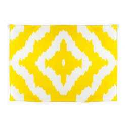 AphroChic - Haze Mimosa Placemat - If your table needs livening up, look no further than these sunny ikat patterned placemats from Aphrochic. You'll want to plan your entire tablescape around this cheerful base!