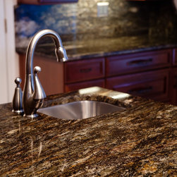 Saturnia Granite - Saturnia Granite is an exotic stone with black and caramel as well as large amounts of silver mica and quartz veining.