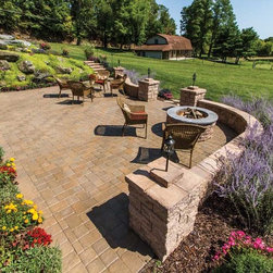 """EP Henry Patio in Old Towne Cobble™ - Patio in Old Towne Cobble™, Modified Herringbone Pattern with 6"""" Double Sided Walls and a EP Henry Fire Pit Kit, all in Harvest Blend"""