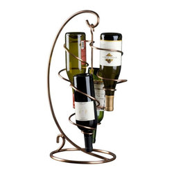 """Oenophilia - Oenophilia Copper Tendril 4-Bottle Table Top Wine Rack Multicolor - 010044 - Shop for Wine Bottle Holders and Racks from Hayneedle.com! Trendy twisty tendrils (try saying that over and over) give the Oenophilia Copper Tendril 4-Bottle Table Top Wine Rack its elegant artistic flair. This metal wine rack features intertwining tendrils to store and display four bottles of wine. It's designed to hold bottles with the corks pointing down allowing them to stay moist. The compact size of this wine rack makes it perfect for tabletops and counters while the warm copper finish allows it to blend easily with your home decor. About OenophiliaWith a name Greek in origin meaning """"the love of wine """" Oenophilia delights in fulfilling its mission to bring together products that allow others to love wine with the passion that Oenophilia does. After creating their first product in 1983 the Oenophilia team has continued to produce and manufacture superior wine accessories and is known as one of the leading wholesale suppliers of wine accessories and gifts in the U.S. Although located in Hillsborough NC traveling the world has allowed Oenophilia to provide customers with a premium extensive collection of wine accessories including openers wine racks glassware and gifts. Oenophilia carries their signature line of original designs and packaging as well as exceptional brands such as Vacu-Vin Metrokane Rogar Srewpull and Spiegelau. Bringing eclectic wine products competitive pricing and responsive customer service to the table is the Oenophilia team's way of sharing their passion while achieving their goal of providing customers with a luxurious one-stop shopping experience."""